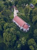 Aerial Photo of an Old Lutheran Church in Countryside Between Trees in Early Spring on Sunny Day, Close up - Concept of Harmony stock images