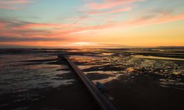 British pier in England during the sunset. Aerial photo of the pier in northwest England town Southport. Photi taken during the sunset Royalty Free Stock Photo