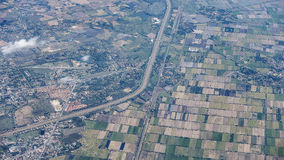 Aerial photo. From a plane, top view, field roads and city,wide aerial view of agricultural area Stock Photography