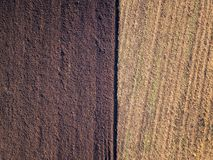 Aerial photo of a ploughed field in a countryside royalty free stock image