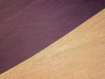 Aerial photo of a ploughed field in a countryside royalty free stock images