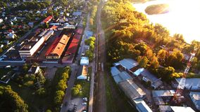 Aerial photo of railroad in city and trees stock photos