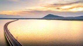 Aerial Photo Railway Bridge Over lake Pa Sak Dam Lopburi Thailan. D beautiful sunlight Golden hour Stock Photo