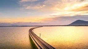 Aerial Photo Railway Bridge Over lake Pa Sak Dam Lopburi Thailan. D beautiful sunlight Golden hour Stock Photography