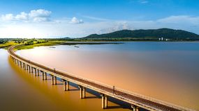Aerial Photo Railway Curve Track to the mountains is located on. The River Pasak River Dam,Lopburi Thailand Stock Images