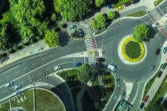 Aerial photo of a roundabout with grass  in the. Aerial photo of a roundabout with grass and trees in the middle from bird's view Stock Photography