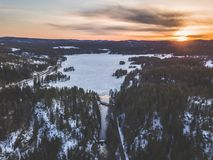 Aerial Photo Of Snowy Forest During Sunset Royalty Free Stock Images