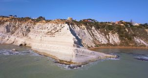 Aerial photo Stair of the Turks in Italian Scala dei Turchi rocky cliff. On coast of Realmonte near Porto Empedocle southern stock footage