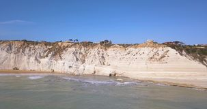 Aerial photo Stair of the Turks in Italian. Scala dei Turchi rocky cliff on coast of Realmonte near Porto Empedocle southern Sicily Italy stock footage