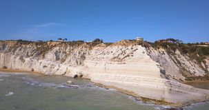 Aerial photo Stair of the Turks in Italian. Scala dei Turchi rocky cliff on coast of Realmonte near Porto Empedocle southern Sicily Italy stock video footage