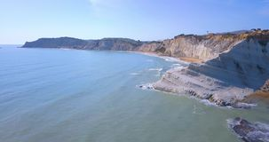 Aerial photo Stair of the Turks in Italian. Scala dei Turchi rocky cliff on coast of Realmonte near Porto Empedocle southern Sicily Italy stock video