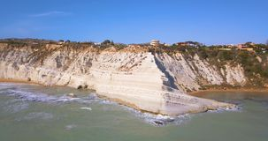 Aerial photo Stair of the Turks in Italian Scala. Dei Turchi rocky cliff on coast of Realmonte near Porto Empedocle southern Sicily stock footage