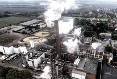 Industrial plant with smoking chimneys, alienated, aerial photo Royalty Free Stock Images