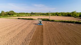 Tractor ploughing a field in the french countryside Royalty Free Stock Image