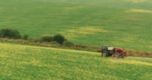 Farm Tractor Spray Autumn Crop Field. Aerial photo. stock photos