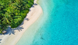 Aerial photo of tropical Maldives beach on island. Aerial photo of beautiful paradise Maldives tropical beach on island. Summer and travel vacation concept royalty free stock images