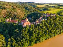 Aerial photo of Veveri castle near Brno city. South Moravia region, surrounded by river Svratka. Summer day with blue sky, sunset. And soft light stock photo