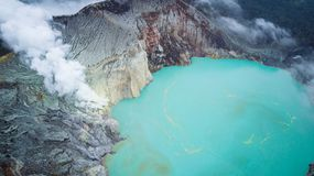 Aerial photo of volcano Ijen in East Java, Indonesia. Acidic crater lake with turquoise sulphuric water. Aerial photo of volcano Ijen in East Java, Indonesia royalty free stock images
