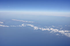 Aerial photo of the waterscape and cloudscape stretching all the way to the horizon Royalty Free Stock Photo
