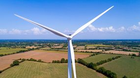 Aerial photo of a wind turbine in a field Royalty Free Stock Photo