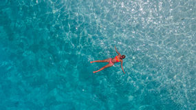 Aerial photo of woman in blue water of Indian ocean Royalty Free Stock Image
