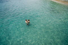 Aerial photo of young couple on holidays swimming in ocean Royalty Free Stock Image
