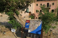 Aerial photograph map on the central square of medieval castle town of Monemvasia island. Aerial photograph map on the central square of medieval castle town of stock images