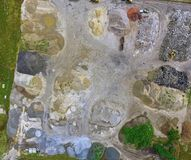 Aerial photograph of piles of rubble, sand, gravel and bricks an. D recycled materials in a warehouse Royalty Free Stock Images