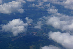 Aerial photograph of rural Eastern USA. With clouds, fields, river, houses, and roads Stock Images