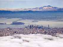 Aerial Photograph of San Francisco and The Bay Area. San Francisco shrouded in fog with Mt Diablo in the distance Stock Image