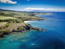 Honolua Bay Aerial Photography with small boat stock images