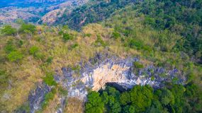 Aerial photography above amazing cave. Aerial photography a big hole in front of Thanlod Yai cave in Kanchanaburi Royalty Free Stock Image