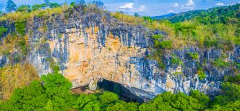 Aerial photography above amazing cave. Aerial photography a big hole in front of Thanlod Yai cave in Kanchanaburi Royalty Free Stock Images