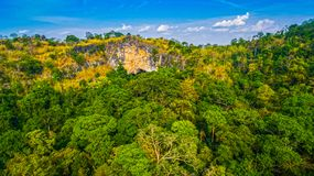 Aerial photography above amazing cave. Aerial photography a big hole in front of Thanlod Yai cave in Kanchanaburi Stock Image