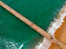 Aerial Photography of Brown Boardwalk Near Green Water on Beach Royalty Free Stock Photography