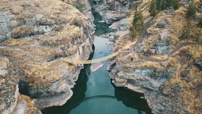Aerial Photography of Brown Hanging Bridge Connecting Two Cliffs stock image