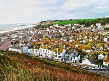 Aerial Photography of Brown Roofed Houses Near Sea Royalty Free Stock Photos