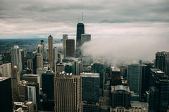 Aerial Photography of City High Rise Building Under Gray Cloudy Sky during Daytime Stock Photo