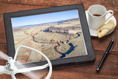 Aerial photography concept - Colorado foothills. Aerial photography concept - reviewing pictures of Colorado foothills with a stream and cliff on a digital royalty free stock image