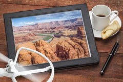 Aerial photography concept - Colorado River. Aerial photography concept - reviewing pictures of Colorado River canyon near Moab, Utah, on a digital tablet with a stock photos