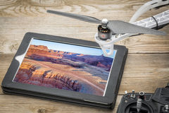 Aerial photography concept - Colorado River. Aerial photography concept - reviewing pictures of Colorado River canyon near Moab, Utah, on a digital tablet with a royalty free stock images
