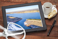 Aerial photography concept - mountain lake. Aerial photography concept - reviewing aerial pictures of the Horsetooth Reservoir on a digital tablet with a drone stock images