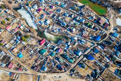 Aerial photography of a a cottage village. With colorful houses, road, green trees and yards. Helicopter drone shot stock photos