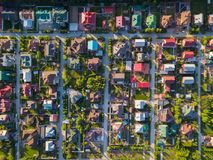 Aerial photography of a cottage village. Aerial photography of  a cottage village with colorful houses, a good road, green trees and yards. Helicopter drone shot Stock Photography