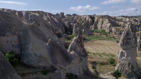 Aerial photography from drone, flight between the mountains of Cappadocia, Goreme. Landscape Panaroma. Aerial view. Turkey 4k stock video