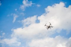 Aerial photography equipment Flying in the blue sky. And copy space royalty free stock images