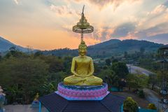 Aerial photography the golden buddha statue in Chiang Rai. Aerial photography the golden buddha statue at wat Sirattanan Mongkol near Mae Kajan Hot Spring Wiang royalty free stock image