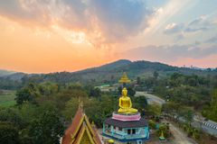 Aerial photography the golden buddha statue in Chiang Rai. Aerial photography the golden buddha statue at wat Sirattanan Mongkol near Mae Kajan Hot Spring Wiang stock photos