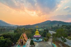 Aerial photography the golden buddha statue in Chiang Rai. Aerial photography the golden buddha statue at wat Sirattanan Mongkol near Mae Kajan Hot Spring Wiang stock images