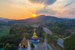 Aerial photography the golden buddha statue in Chiang Rai. Aerial photography the golden buddha statue at wat Sirattanan Mongkol near Mae Kajan Hot Spring Wiang stock image